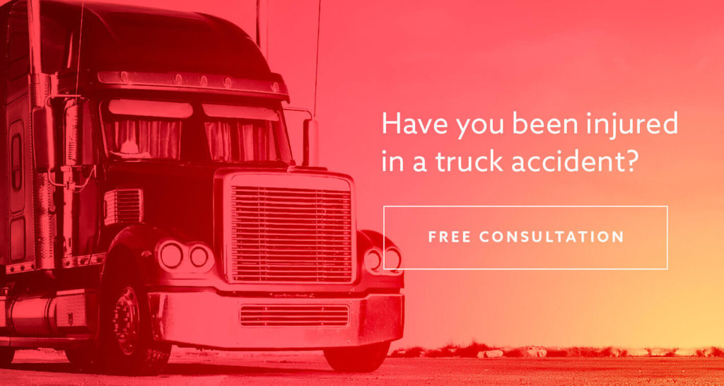 "A commercial truck parked with the text ""Have you been injured in a truck accident?"" superimposed"