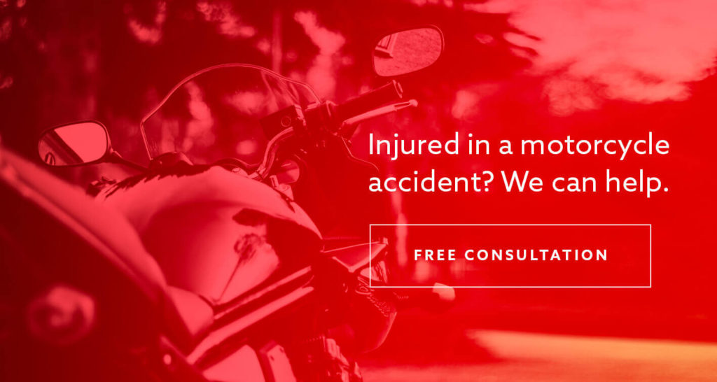 "A motorcycle outside with the text ""Injured in a motorcycle accident? We can help."""