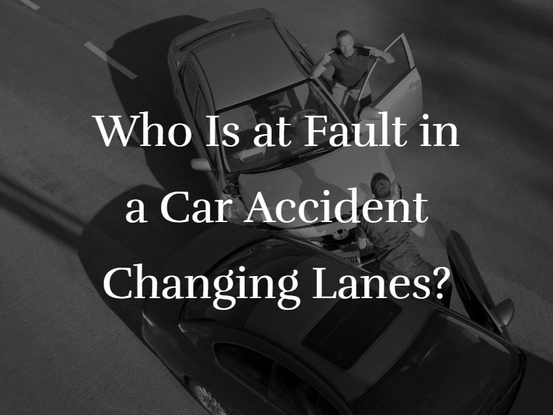 "Two cars crashed on a freeway with the text ""Who Is at Fault in a Car Accident Changing Lanes?"" superimposed"